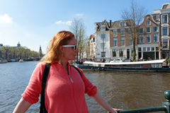 Young native dutch woman in Amsterdam Netherlands. Young native dutch woman on a medieval bridge in Amsterdam Netherlands Stock Photos