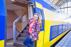 Young native dutch woman getting on a train in Amsterdam  Royalty Free Stock Photos