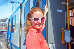 Young native dutch woman getting on the tram in Amsterdam Netherlands Royalty Free Stock Photography