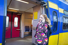 Young native dutch woman making a phone call in Amsterdam Netherlands. Young native dutch woman calling at the train station in Amsterdam Netherlands Royalty Free Stock Photography