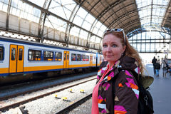 Young native dutch woman waiting for the train in Amsterdam Netherlands Stock Photo