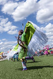 Young native woman spreading arms at dance. Coeur d'Alene, Idaho USA - 07-23-2016. Young dancer participates in the Julyamsh Powwow on July 23, 2016 at the stock photo