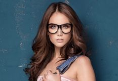 Young natural beauty girl in fashionable eyeglasses. Royalty Free Stock Images