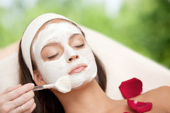 Young Natural Relaxing Beauty Having Moistening Mask Applied Royalty Free Stock Image