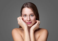 Young natural woman with great skin complexion. Young naturally beautiful woman with great skin complexion Royalty Free Stock Photos