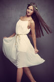 Young natural woman in white dress Stock Photo