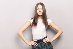 Young naughty beautiful brunette woman posing indoors against wall Royalty Free Stock Photo