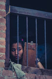 Young Nepalese girl looking to herself in the mirror at home, Bh Royalty Free Stock Photo