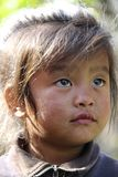 Young Nepalese girl sitting on the abc trail. Young Nepalese girl on the Annapurna base camp hike Stock Image