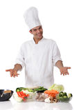 Young nepalese man chef, fresh vegetables Royalty Free Stock Photos