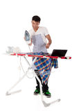 Young Nepalese man, on-line ironing lessons Stock Photo