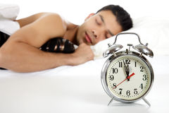 Young nepalese man and retro alarm clock Royalty Free Stock Image