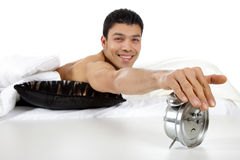 Young nepalese man stopping alarm clock Royalty Free Stock Images