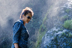Young Nepalese woman in water spray Royalty Free Stock Photography