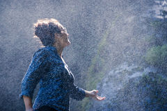 Young Nepalese woman in water spray Stock Photos