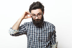 Young nerd bearded businessman touching his glasses Stock Photos