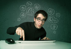 Young nerd hacker with virus and hacking thoughts. On green background Royalty Free Stock Image