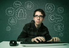 Young nerd hacker with virus and hacking thoughts. On green background Stock Photos