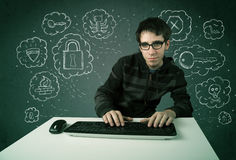 Young nerd hacker with virus and hacking thoughts. On green background Stock Photography