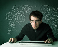 Young nerd hacker with virus and hacking thoughts. On green background Royalty Free Stock Photography