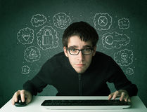 Young nerd hacker with virus and hacking thoughts. On green background Royalty Free Stock Photo