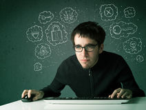 Young nerd hacker with virus and hacking thoughts Stock Photos