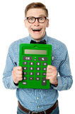 Young nerd showing big green calculator Royalty Free Stock Photo