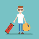 Young nerd travelling with his luggage Stock Photo
