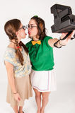 Young nerdy girls taking a selfie with instant cam Royalty Free Stock Photo