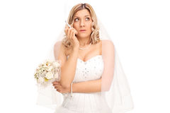 Young nervous bride smoking a cigarette Stock Image