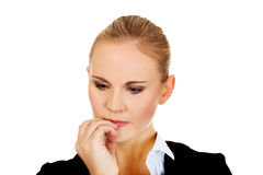Young  nervous business woman biting her nails Royalty Free Stock Photography