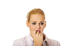 Young nervous business woman biting her nails Royalty Free Stock Images
