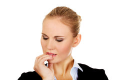 Young  nervous business woman biting her nails Stock Photo