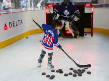 Young New York Rangers fan shooting the puck before Rangers season opening match at Madison Square Garden in NYC Stock Photo