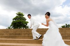 Young newly married couple chasing each other Stock Images