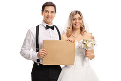 Young newlywed couple with blank cardboard sign Stock Images