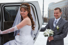 Young newlywed couple sitting in vehicle Royalty Free Stock Photos
