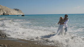 Young newlyweds rejoice in the ocean stock footage