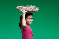 Young nicaraguan girl carrying food on her head Stock Image