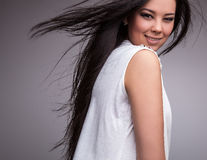 Young nice asian girl poses in studio. Stock Photography