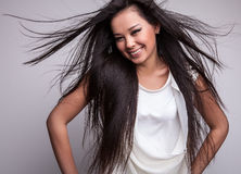 Young nice asian girl poses in studio. Stock Photos