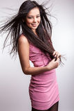 Young nice asian girl poses in studio. Royalty Free Stock Photography