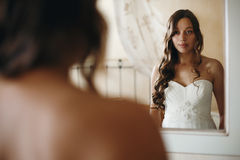 Young Nice Bride Looking in Mirror Stock Photography