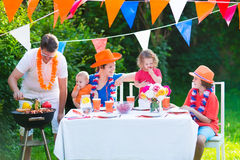 Young nice dutch family having grill party Stock Image