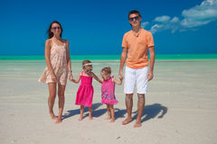 Young nice family with two kids walking at beach Stock Photo
