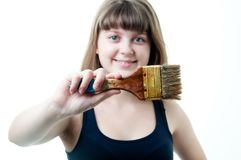 Young nice girl with brush on white background Stock Photo
