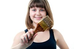 Young nice girl with brush on white background Stock Photos