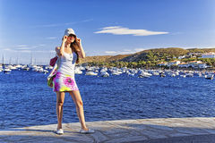 Young nice girl on the mediterranean sea quay Royalty Free Stock Photos