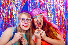 Young nice girls have fun. On a dance party Stock Images