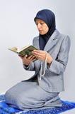 Young nice muslim female praying on traditional wa Royalty Free Stock Photo